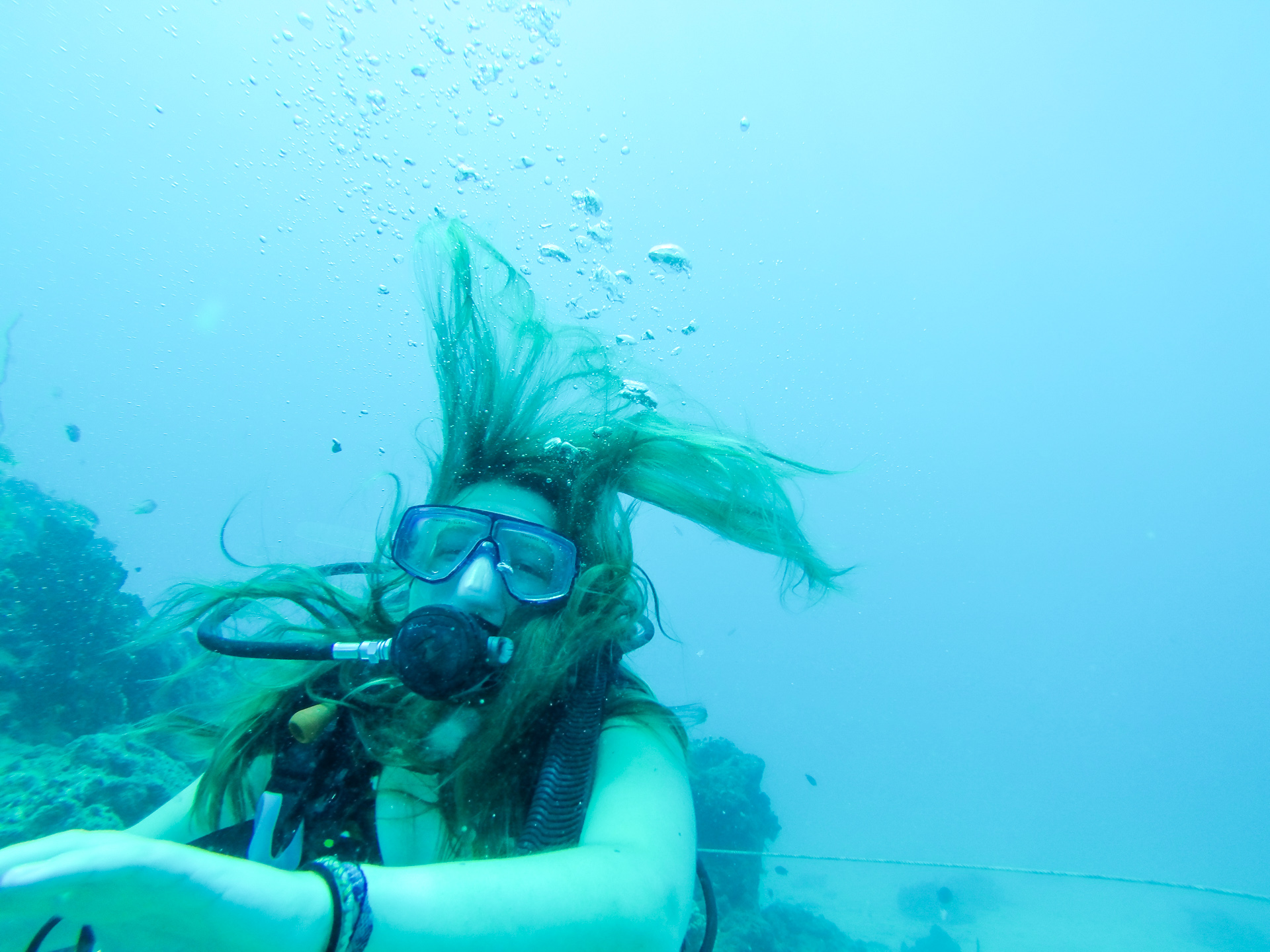 Alis laughing underwater diving waters of South Sea Island, Fiji