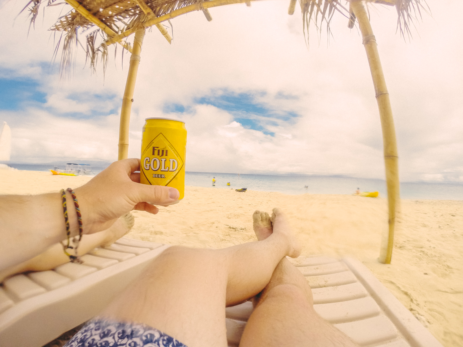 Drinking Fiji Gold Beer on golden beach of South Sea Island, Fiji