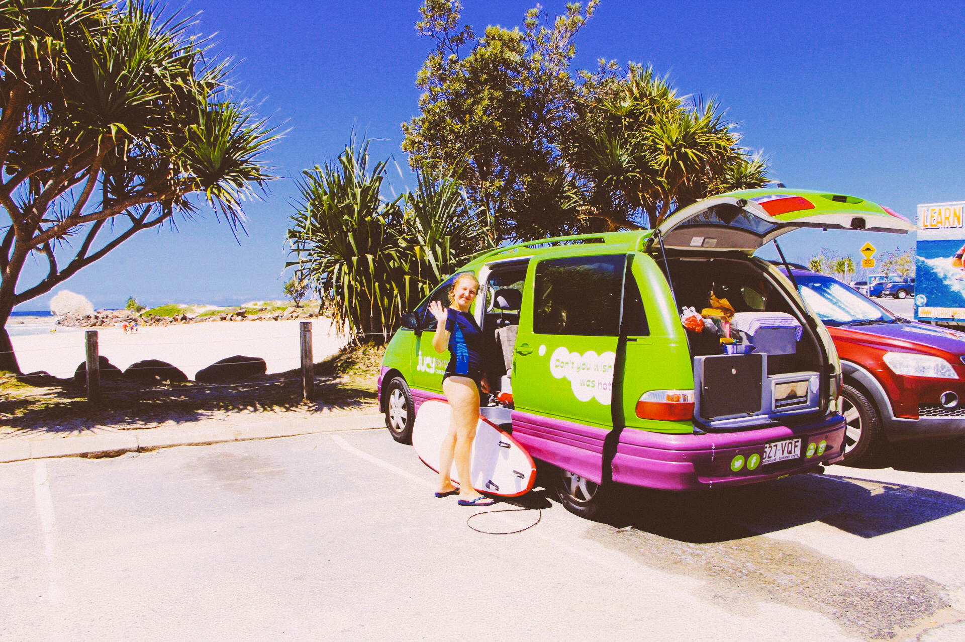 Jucy Campervan with surfboard at Currumbin, Australia