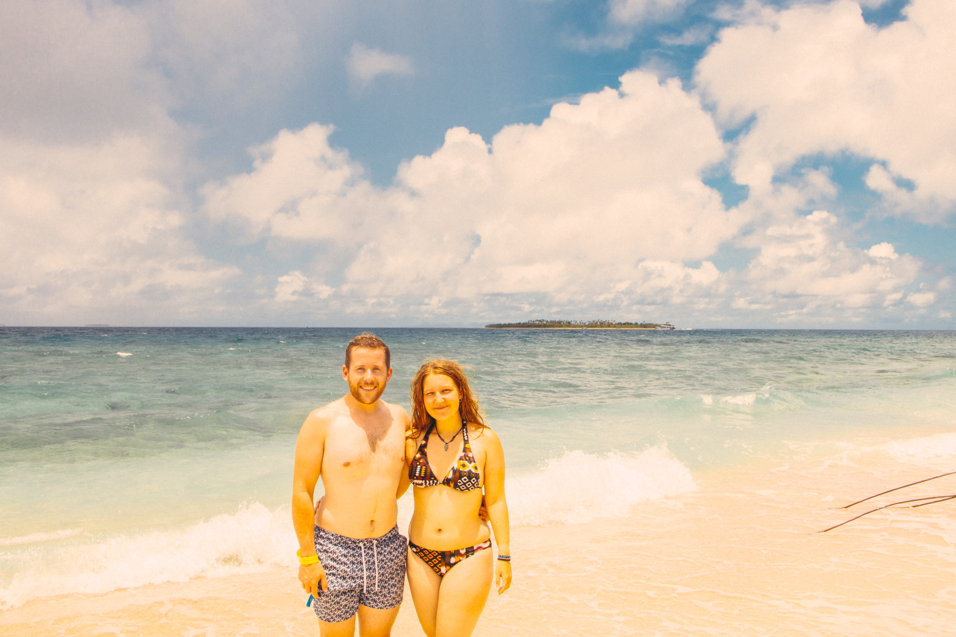 Alex and Alis on golden beach at South Sea Island, Fiji