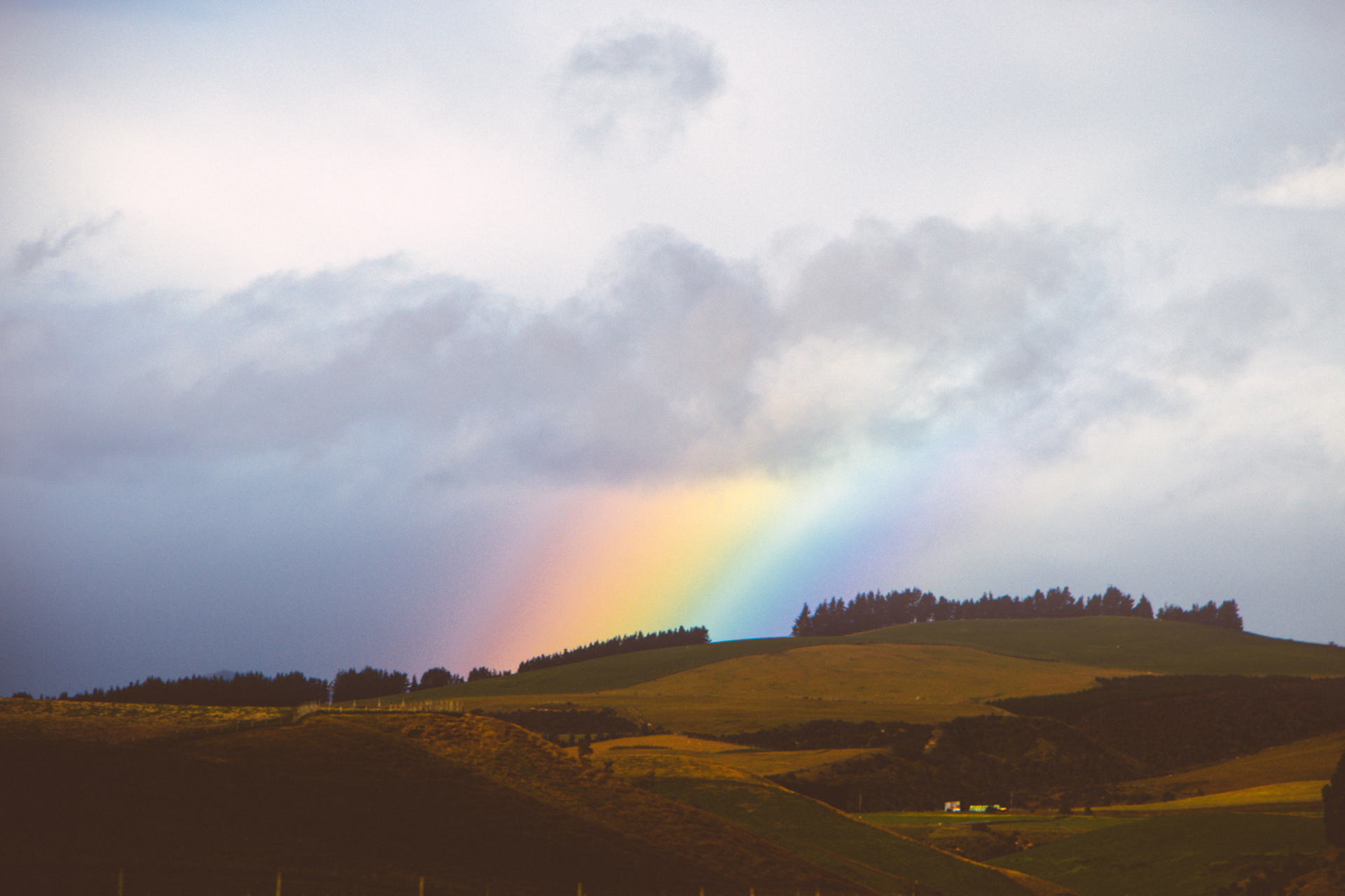 Rainbow over New Zealand Mountains