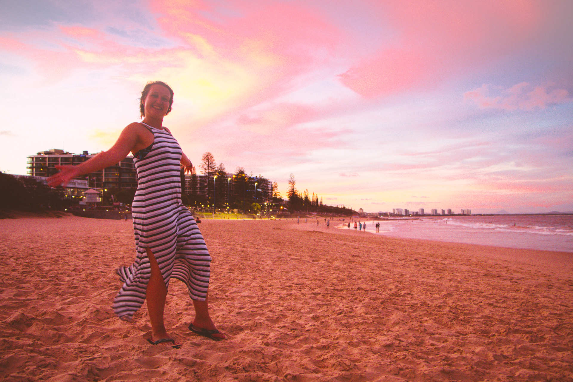 Alis enjoying sunset on a lush golden beach