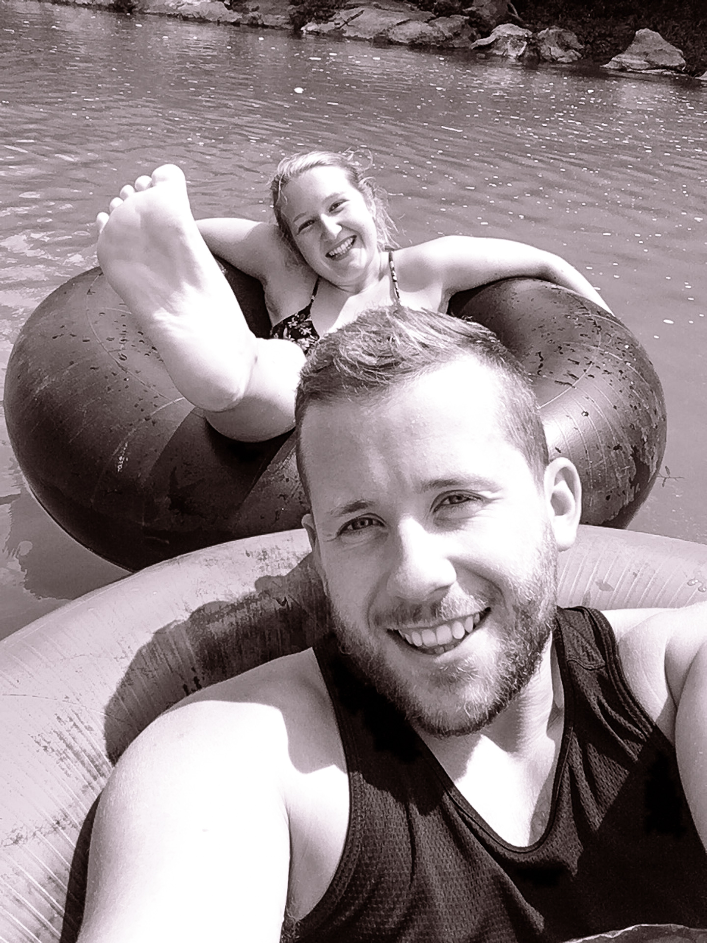Alex and Alis Digital Nomads Float on River in Vang Vieng