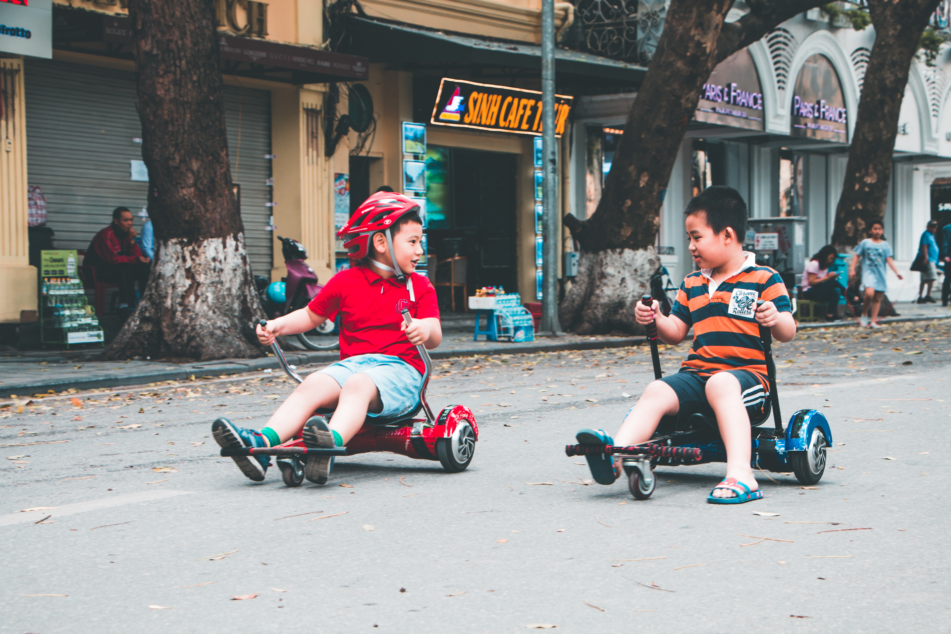 Children Playing on Sitdown Swegways in Hanoi