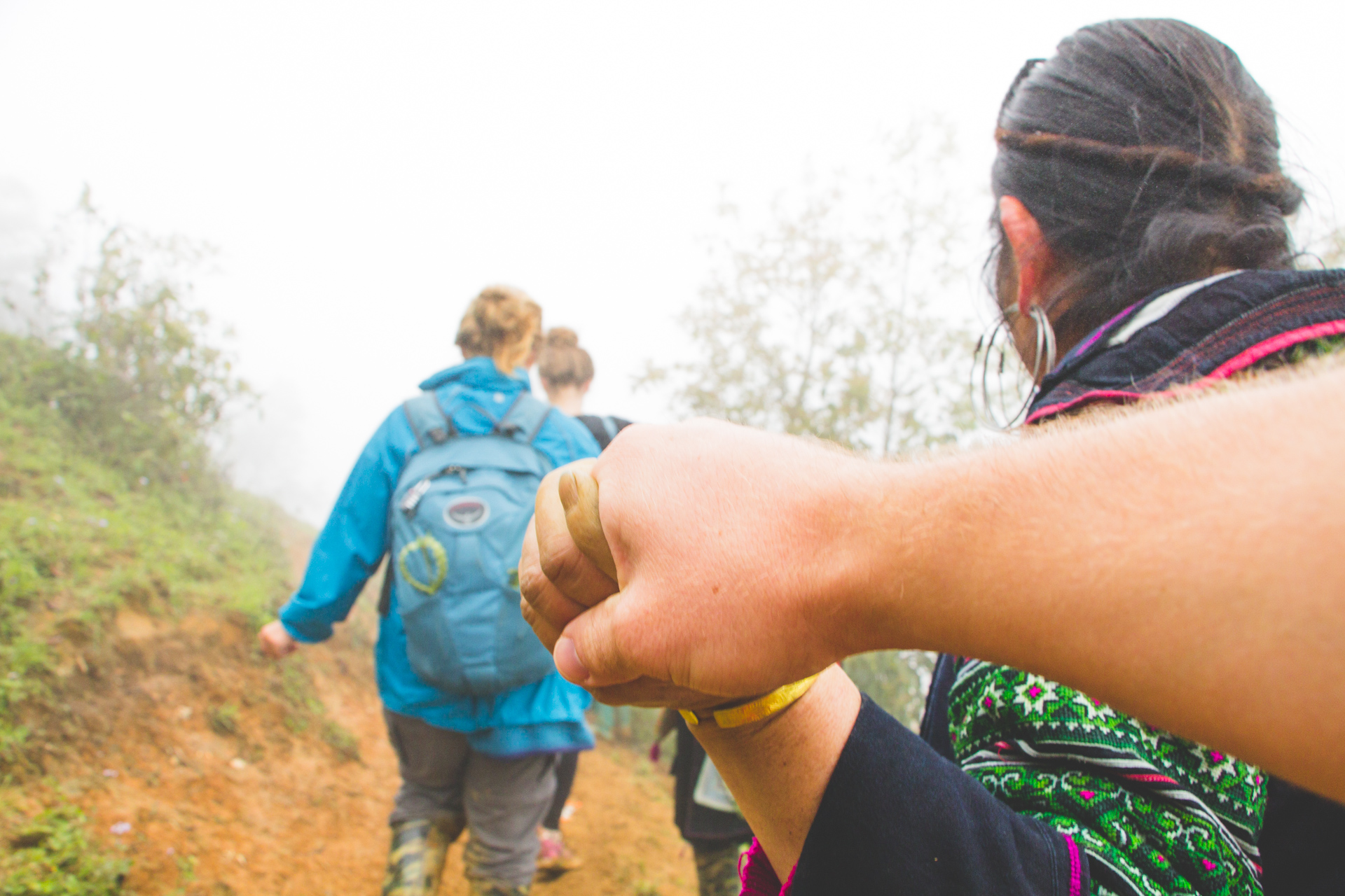 Sapa villager holding hand on way down