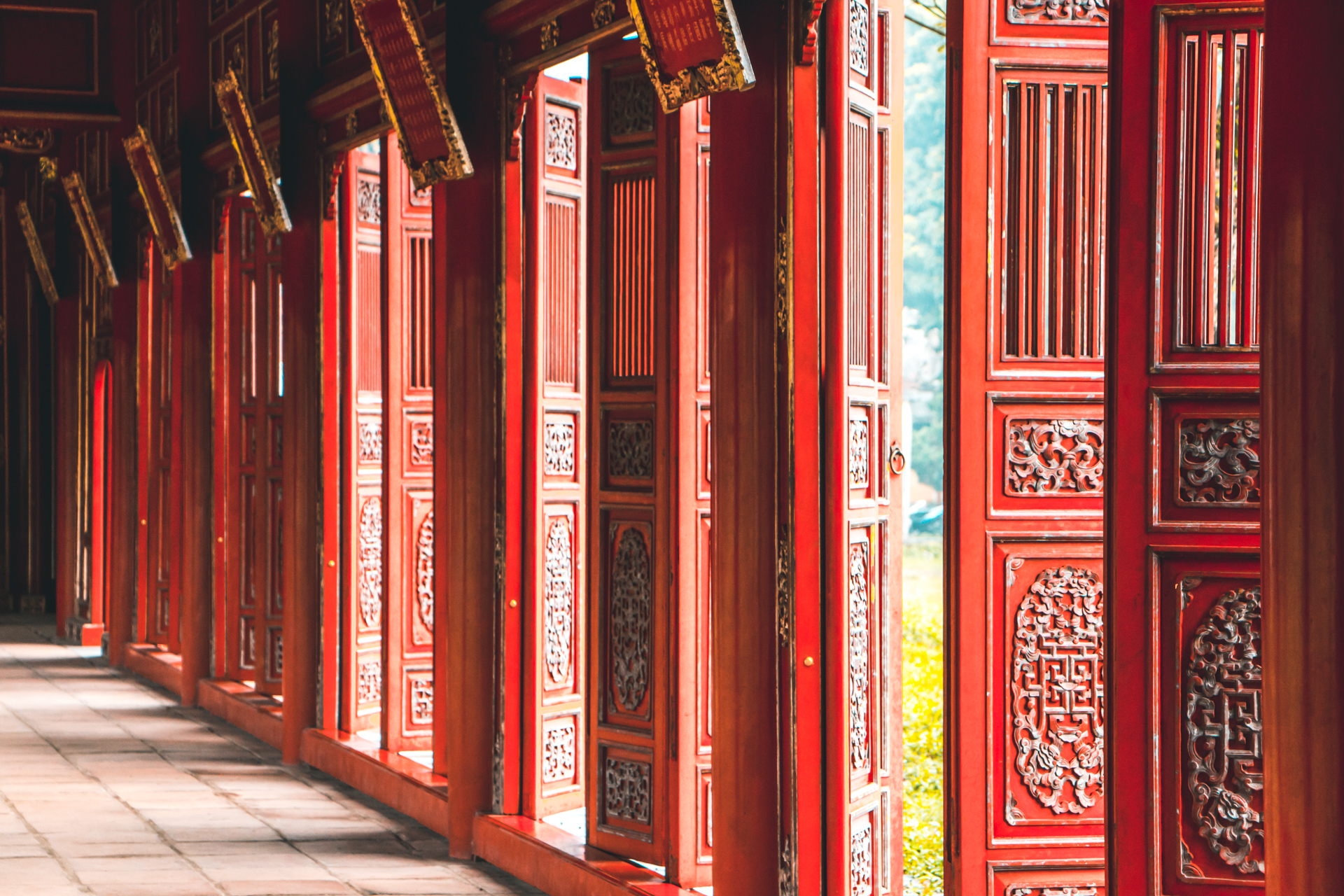 Vibrant Red Traditional Doors in Hue Citadel, Vietnam